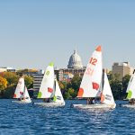 Members of the UW Sailing Team hold group races with their dinghy sailboats on Lake Mendota at the University of Wisconsin-Madison during a mild autumn day on Oct. 6, 2011. The co-ed and student-run UW Sailing Team is part of the Hoofer Sailing Club and competes nationally against several university sailing programs with varsity-level funding.  (Photo by Bryce Richter / UW-Madison)