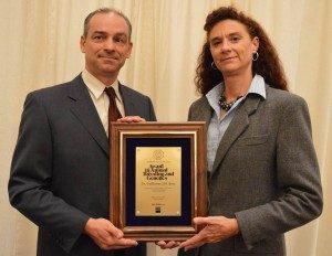 Rosa accepts award